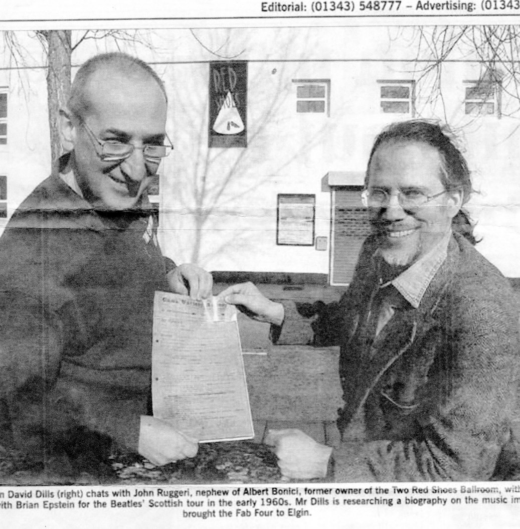 John Ruggeri with David Dills holding the Beatles contract that brought them to the Two Red Shoes