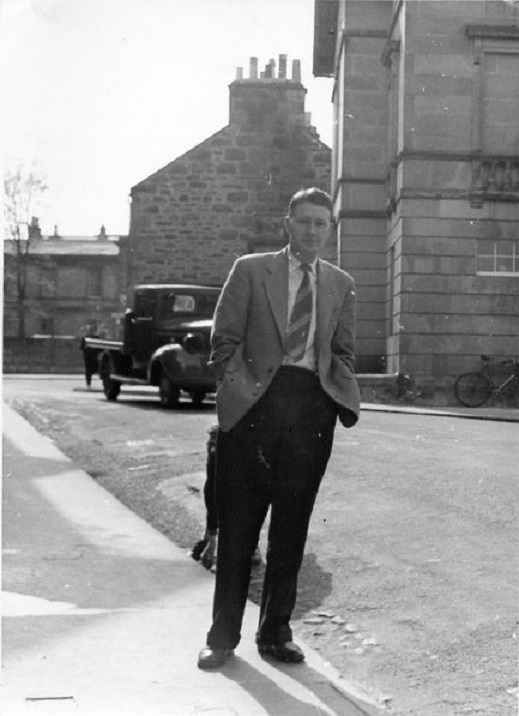 "Henry ""Harry"" Robertson standing next to the Park Cafe where he performed musicials and piano recitals to a packed house. Building to the right is the Elgin Museum on South College Street, Elgin, Scotland"
